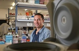 Dr. Amnon Buxboim in his lab