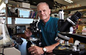 Prof. Giora Simchen in his lab
